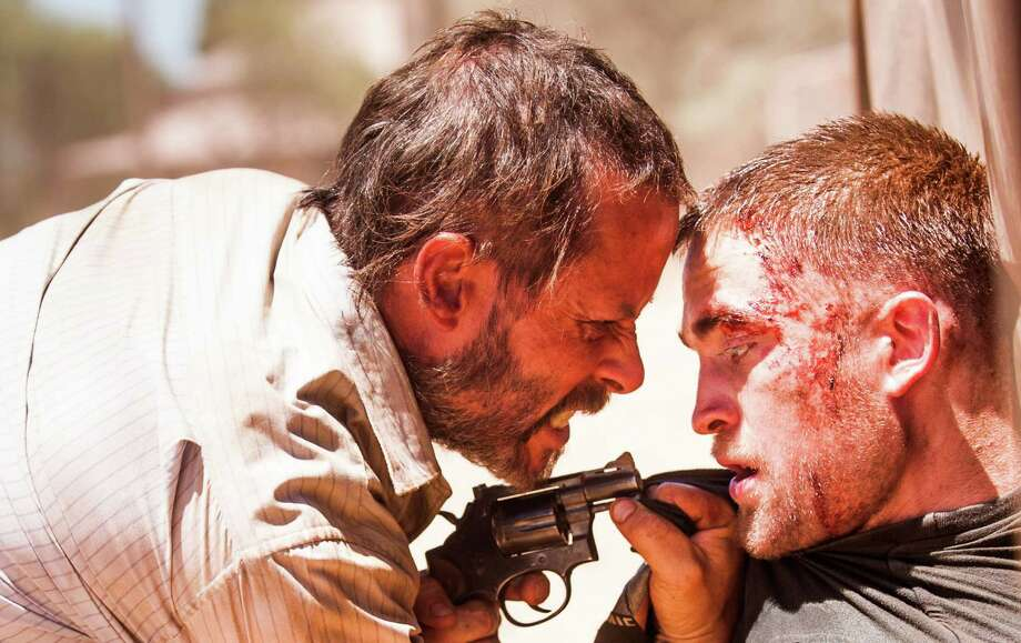 "This image released by A24 Films shows Guy Pearce, left, and Robert Pattinson in a scene from ""The Rover."" (AP Photo/A24 Films) ORG XMIT: NYET516 / A24 Films"