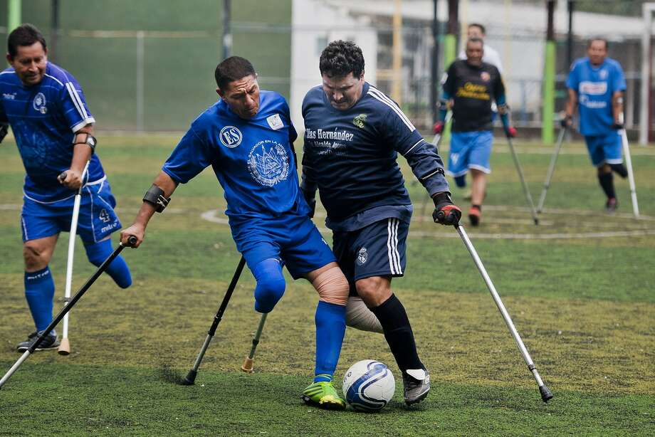 Futbol on one leg:In Ilopango, El Salvador, the national amputee football Team scrimmages during a practice session. Photo: Jose Cabezas, AFP/Getty Images