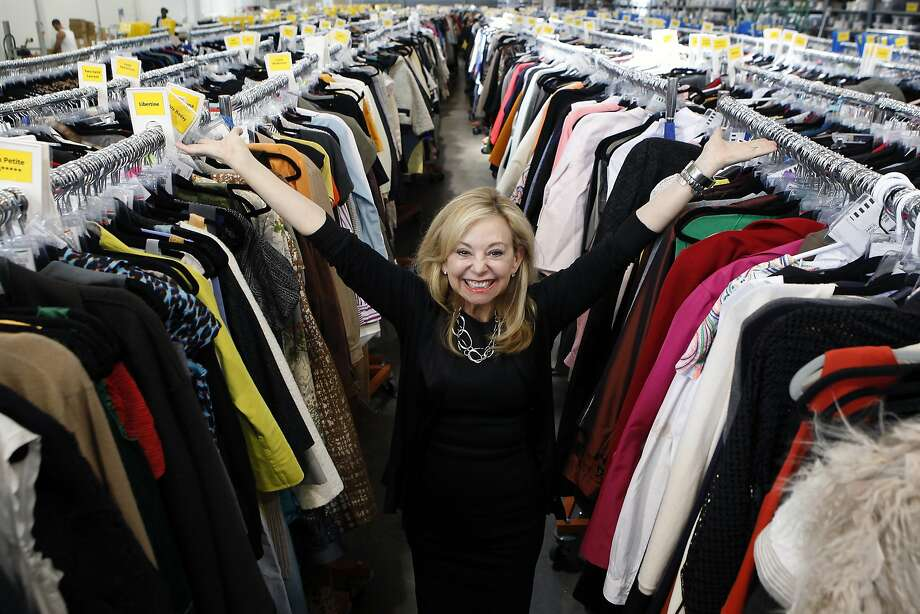 Founder and CEO Julie Wainwright stands among racks of clothing at the headquarters of her resale and consignment company. Photo: Michael Short, The Chronicle