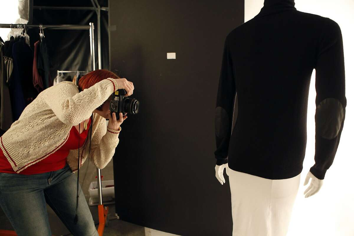 Bonnie Mills photographs clothing items on a mannequin at the headquarters of online luxury resale and consignment company The RealReal in San Francisco, CA, Wednesday June 18, 2014.