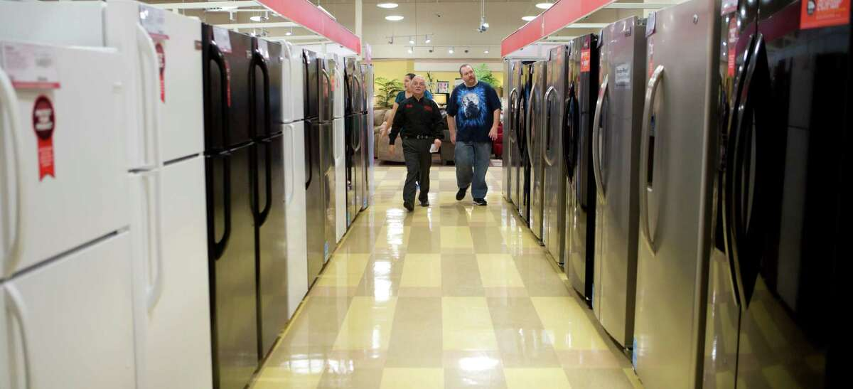 Conn's customers visit the kitchen appliances department at a store in Spring. The chain is based in The Woodlands.