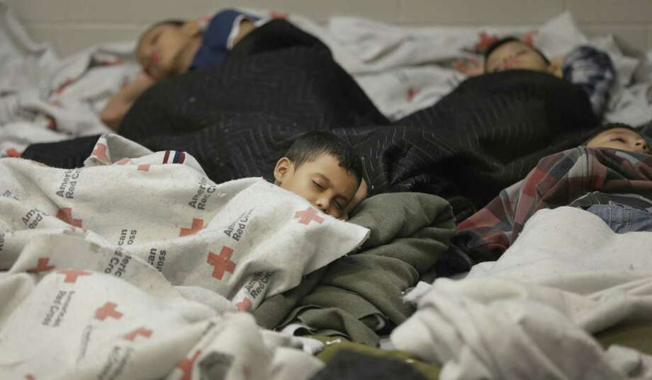 Detainees sleep in a holding cell at a U.S. Customs and Border Protection processing facility in Brownsville. More than 47,000 unaccompanied children have entered the country since Oct. 1. Photo: Eric Gay / Associated Press / Pool AP