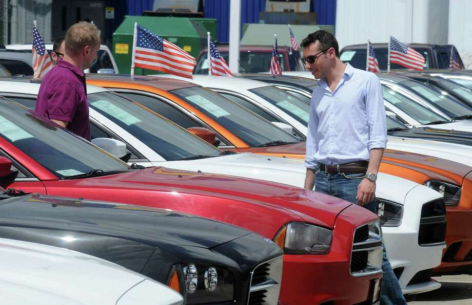 Jovanne Barsano, right, looks at Dodge Chargers at Helfman Dodge Chrysler Jeep Ram. Auto sales in the Houston area are at their highest level for any 12-month period since 2002, a report says. Photo: Dave Rossman, Freelance / © 2014 Dave Rossman