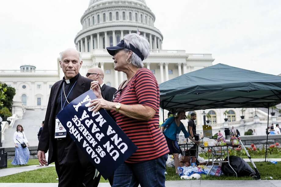 Archbishop Salvatore Cordileone talks with a fellow participant during the March for Marriage rally Thursday. Photo: T.J. Kirkpatrick, Special To The Chronicle