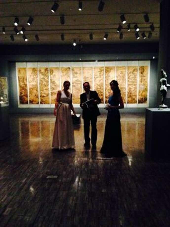 Asian Art Museum curator Allison Harding torus guests through the exhibition.