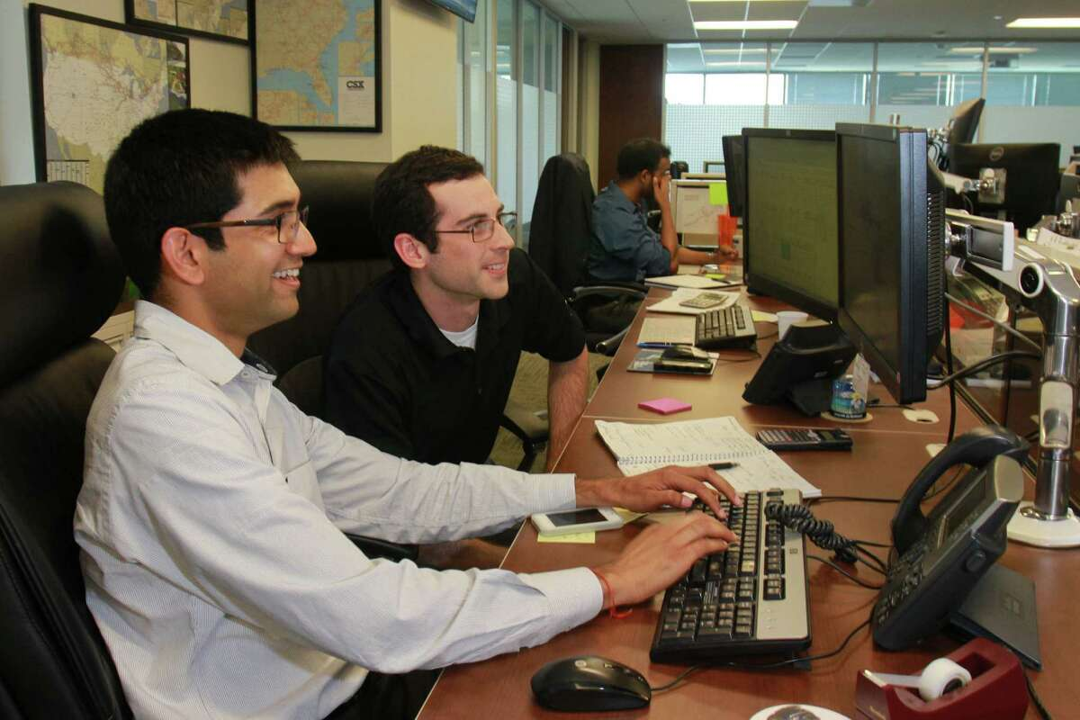 (For the Chronicle/Gary Fountain, May 19, 2014) Traders Sandeep Sukumar, left, and Vincent Kubeczka working on the trading floor at BioUrja, an energy commodities trading company focusing on the purchase and sale of ethanol, petroleum products, and crude oil.
