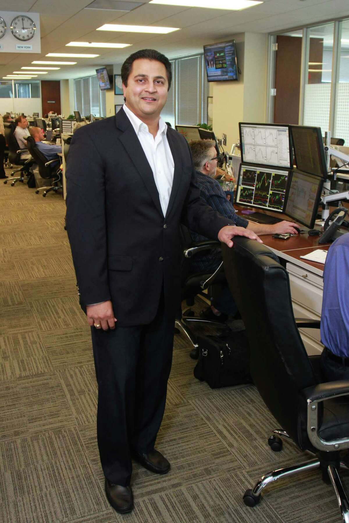 (For the Chronicle/Gary Fountain, May 19, 2014) Amit Bhandari on the trading floor of BioUrja. Amit is the founder and CEO of BioUrja, an energy commodities trading company focusing on the purchase and sale of ethanol, petroleum products, and crude oil.