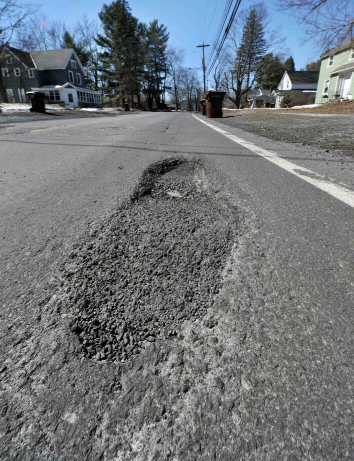 Potholes on Kenwood Avenue near Gardiner Terrace Tuesday March 18, 2014, in Bethlehem, N.Y.  (John Carl D'Annibale / Times Union archive) Photo: John Carl D'Annibale / 00026192A