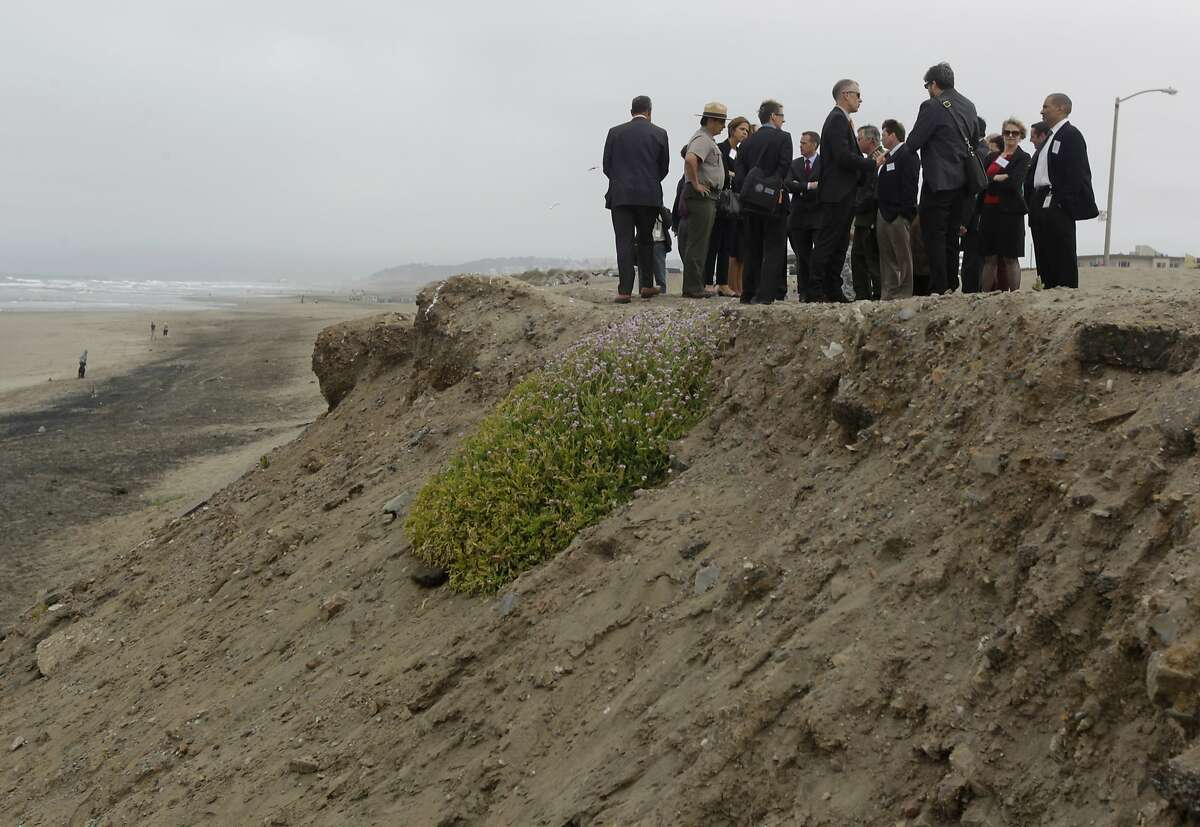 Local, state and federal representatives tour the eroding bluffs at Ocean Beach with Mike Boots, acting chair of the White House Council of Environmental Quality, in San Francisco, Calif. on Thursday, June 19, 2014. Boots was updated on the city's Ocean Beach Master Plan, which outlines a comprehensive, long-term vision over the next 40 years to address sea level rise, protect critical wastewater infrastructure, restore coastal ecosystems, manage a changing coastline, and improve public access to the beach.