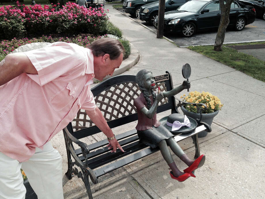 "Jack Bordeaux of Stamford points to the spot where a copper handbag was welded to a public art display called ""Mommy's Shoes"" which was installed at Latham Park in 2002. Photo: John Nickerson / Stamford Advocate"