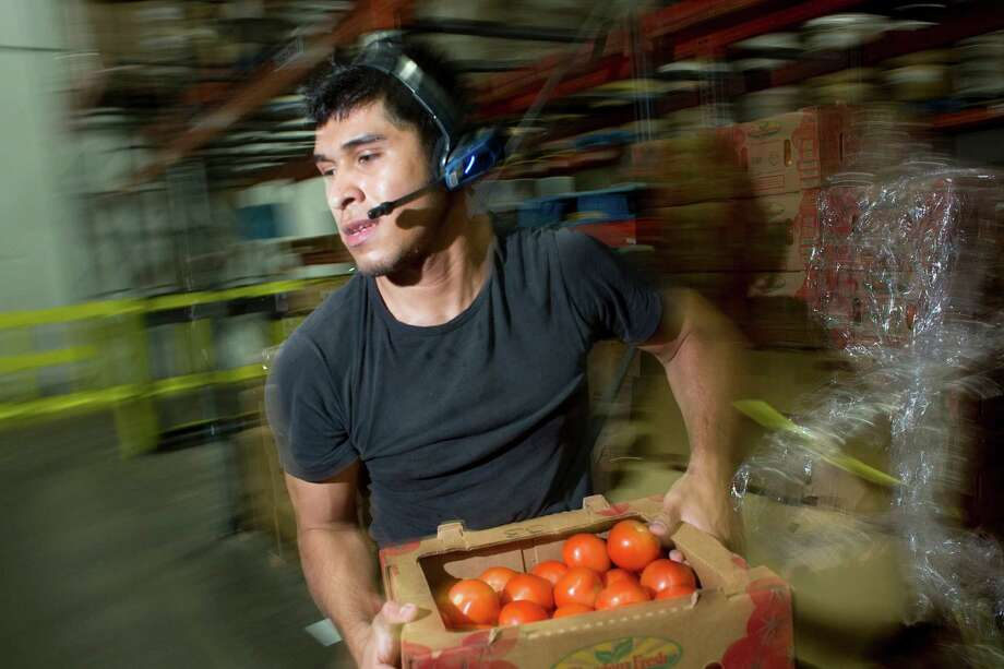 Miguel Orta an order selector at Grocers Supply fills orders at its near-west warehouse and distribution facility in Houston. Grocers Supply  struck a deal with C&S Wholesale Grocers to sell its wholesale distribution business. ( Johnny Hanson / Houston Chronicle ) Photo: Johnny Hanson / © 2014  Houston Chronicle
