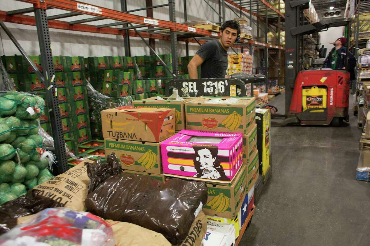 Miguel Orta an order selector at Grocers Supply Company fills orders at its near-west warehouse and distribution facility. Grocers Supply struck a deal with C&S Wholesale Grocers to sell its wholesale distribution business. ( Johnny Hanson / Houston Chronicle )