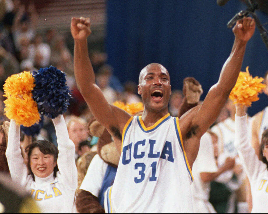 """Q. What is this trial about?A. The NCAA is being sued by former UCLA star Ed O'Bannon and others over the use of their images in broadcasts and video games without compensation. They will argue at trial that the NCAA has acted as a cartel in violation of federal antitrust laws by conspiring to keep players from making money while at the same time pocketing billions of dollars in big television contracts. The NCAA contends that rules on """"amateurism"""" are necessary to retain competitive balance and that a successful lawsuit could create a free-for-all that will seriously damage college athletics.PHOTO: UCLA's Ed O'Bannon celebrates after his team won the NCAA championship game against Arkansas in Seattle on April 3, 1995. Photo: Eric Draper, Associated Press / AP"""