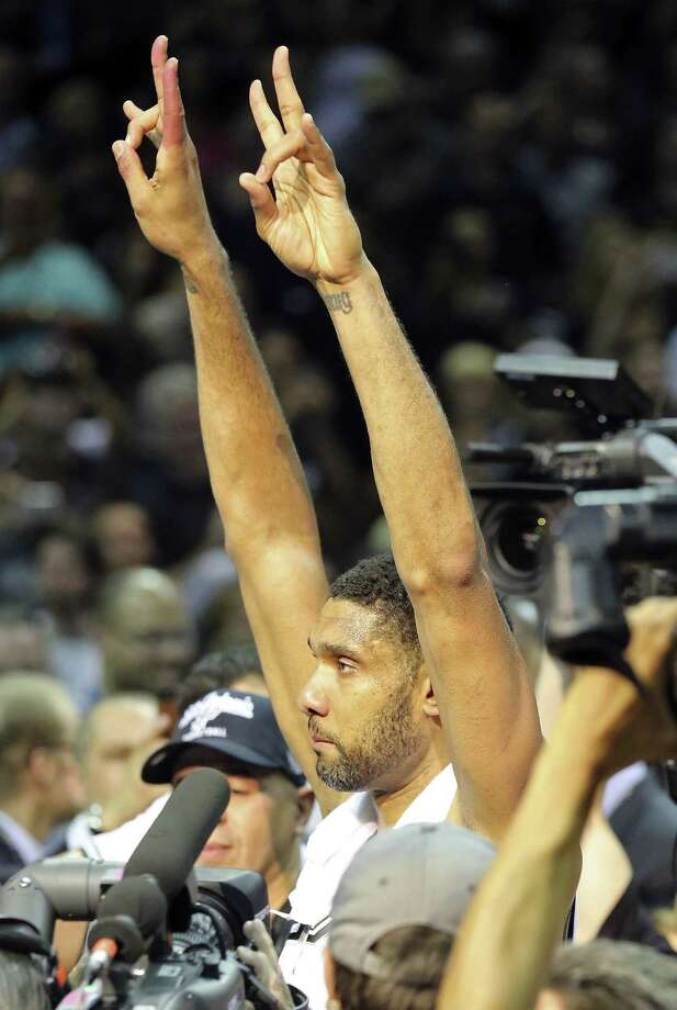 Tim Duncan celebrates after the San Antonio Spurs clinched their fifth NBA title during Game 5 on Sunday against the Miami Heat with a 104-87 win. Photo: Edward A. Ornelas / San Antonio Express-News / © 2014 San Antonio Express-News