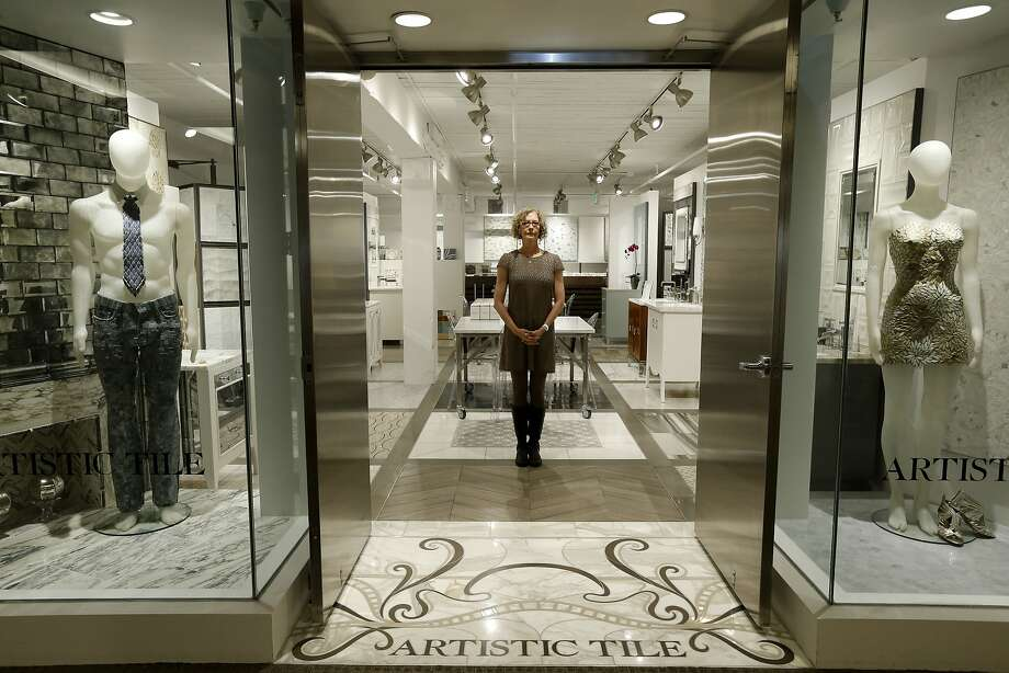 Pam Katz is the showroom manager at Artistic Tile at the San Francisco Design Center. Many of the tenants there may be forced to leave as the landlord uses a landmark law to clear the building for Pinterest. Photo: Michael Macor, The Chronicle