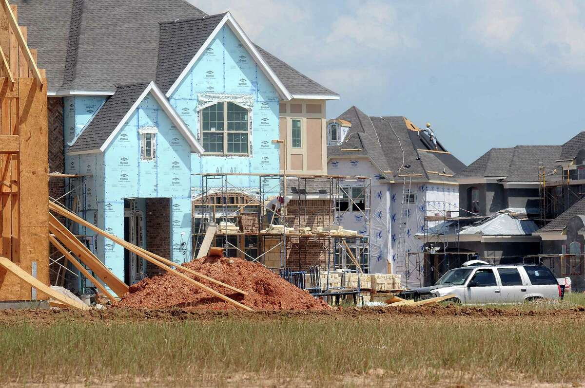 A mix of recent construction and new homes line the streets near the Westridge Creek Recreation Center in Cinco Ranch Friday May 30, 2014.(Dave Rossman photo)