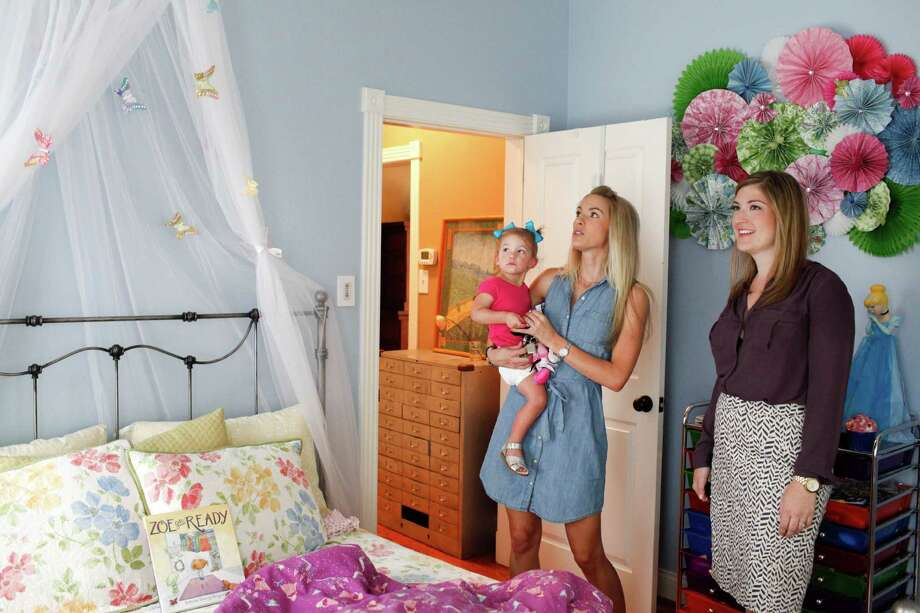 Stephanie Finch, right, of Martha Turner Southeby's International Realty shows a house in the Heights to Casey Scott and her daughter Lyla, 1, June 4, 2014 in Houston.  (Eric Kayne/For the Chronicle) Photo: Eric Kayne / Eric Kayne