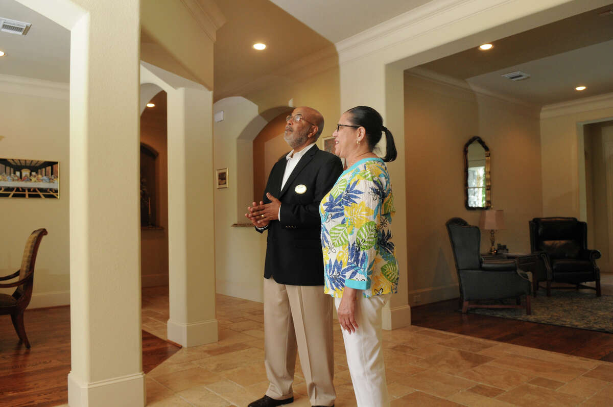 Larry McConnell, left, an agent from Coldwell-Banker United, Realtors, visits with Susie Peterson, in her home in the gated community of Fall Creek in Humble and one of McConnell's premier listings.