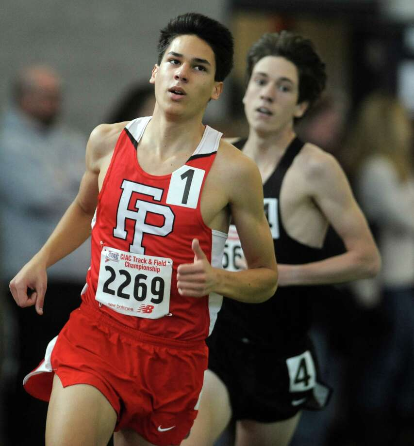 Fairfield Prep's Christian Alvarado competes in the 1600 meter race Saturday, Feb. 8, 2014, during the CIAC Class LL Boys and Girls track championships at the Floyd Little Athletic Center in New Haven, Conn. Photo: Autumn Driscoll / Connecticut Post