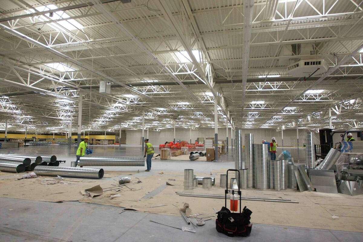 Work crews work on the new 182,000 square foot Walmart Super Center on Thursday, June 5, 2014, in Baytown. ( J. Patric Schneider / For the Chronicle )