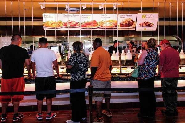 Patrons check out the new Luby's serving line that is part of the Luby's/Fuddruckers that is a new side-by-side restaurant with a shared patio in Pearland, Tx.