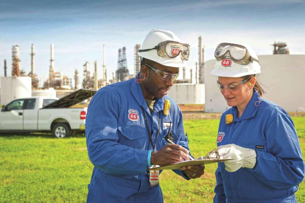 Working in Old Ocean at the Phillips 66 Sweeny Refinery, employees Chidi Opurum and Becky Michel do planning for the Phillips 66 Fractionator 1 project.