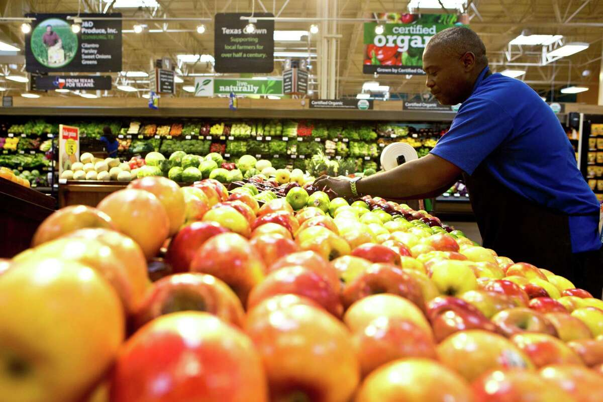 Garvin Crawford, searches for the apples with markings looking to only offer Kroger Marketplace customers the fresh and new apples, Monday, June 2, 2014, in Spring. ( Marie D. De Jesus / Houston Chronicle )