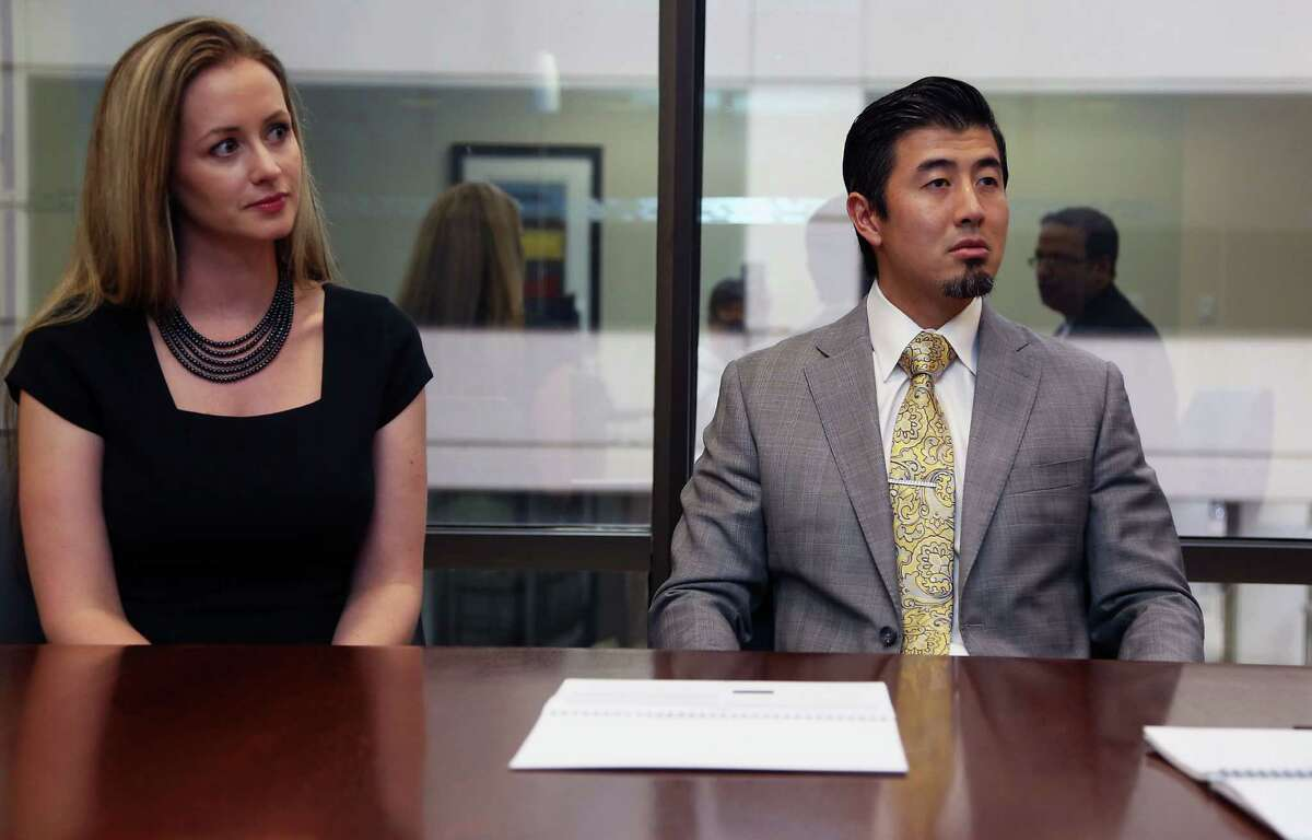 Chase Private Client, clients Kimberly Ang left, and her husband Dimitri Ang Friday, June 6, 2014, in Houston. ( James Nielsen / Houston Chronicle )