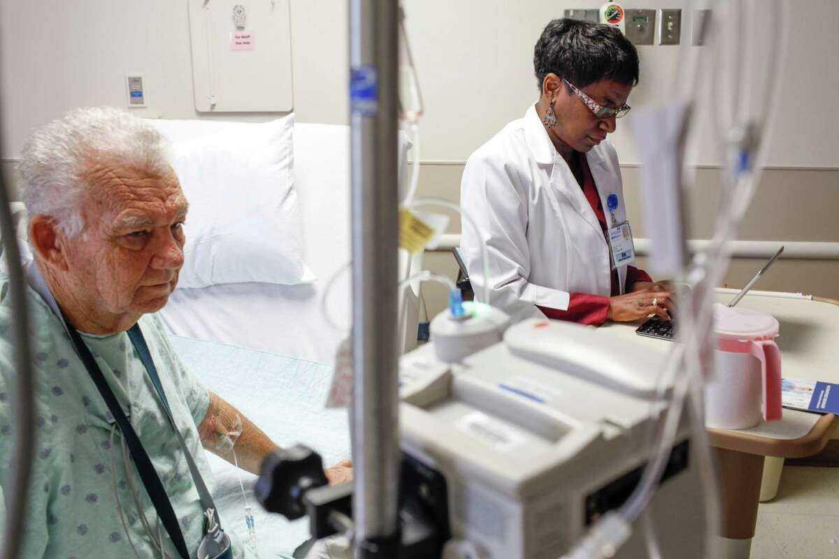 Patient Stephen White talks with health care navigator Angela Nwanze, RN, LBSW, June 4, 2014 in Houston at Methodist Hospital. (Eric Kayne/For the Chronicle)
