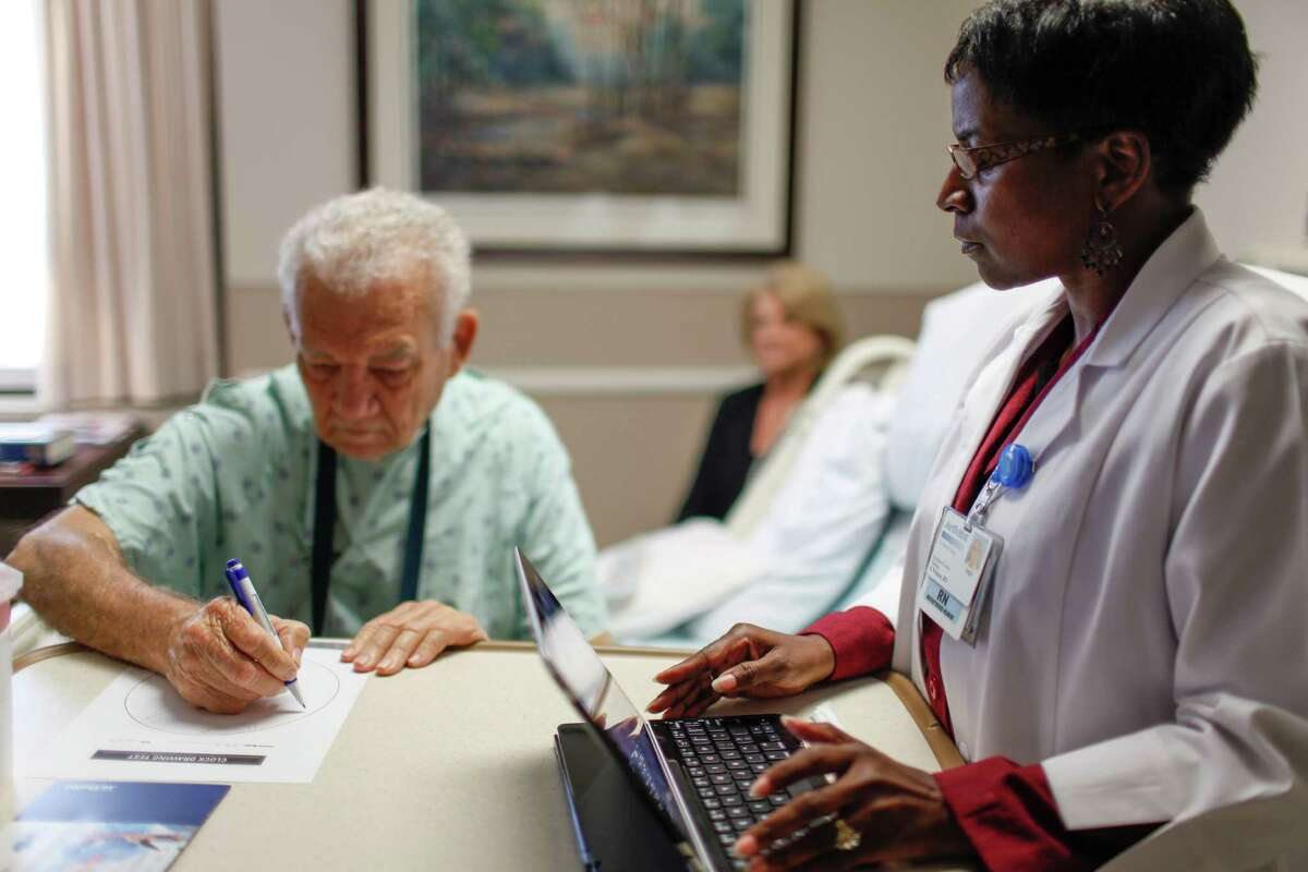Patient Stephen White confers with health care navigator Angela Nwanze at Houston Methodist Hospital.
