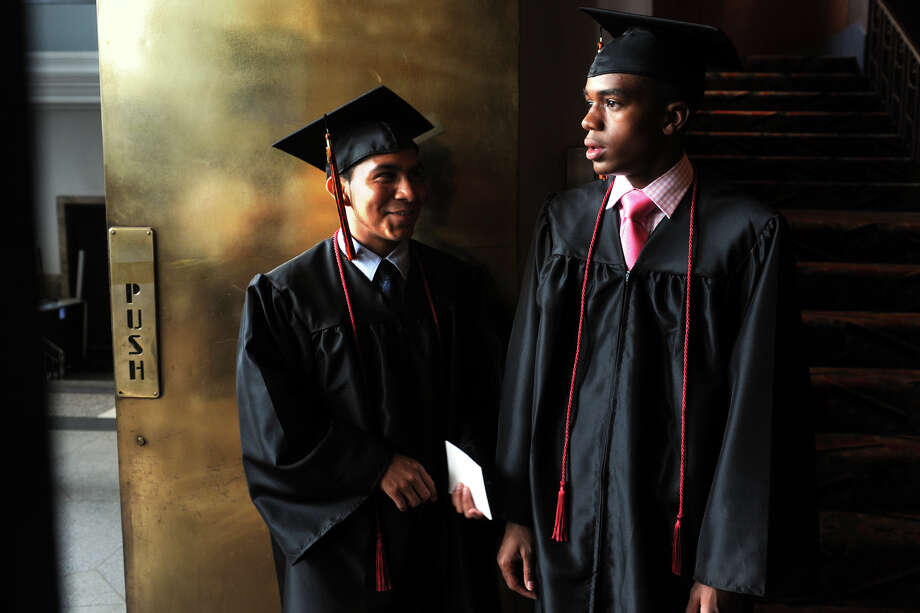 Yanni Vargas, left, and Xavier Staton, both from the Automotive Technology Program, wait to enter Commencement Exercises for the Bullard-Havens Technical High School Class of 2014, held at The Klein Memorial Auditorium, in Bridgeport, Conn. June 19, 2014. Photo: Ned Gerard / Connecticut Post