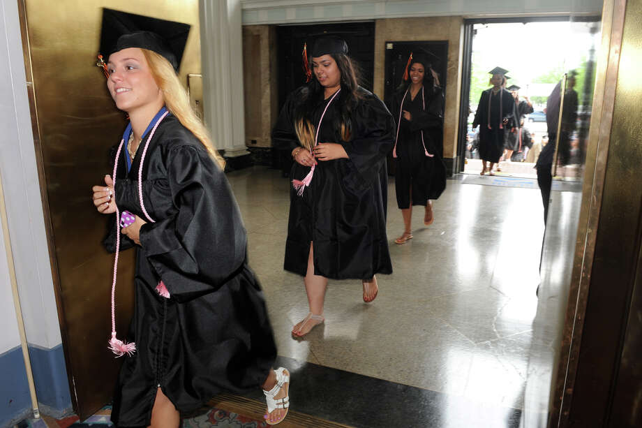 Kari Martin, from the Fashion Merchandising Program, enters Commencement Exercises for the Bullard-Havens Technical High School Class of 2014, held at The Klein Memorial Auditorium, in Bridgeport, Conn. June 19, 2014. Photo: Ned Gerard / Connecticut Post