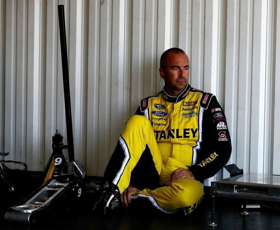 Marcos Ambrose, sitting in the garage during practice for the Pocono 400, developed his racing skills on Australian road courses. Photo: Jeff Zelevansky, Getty Images