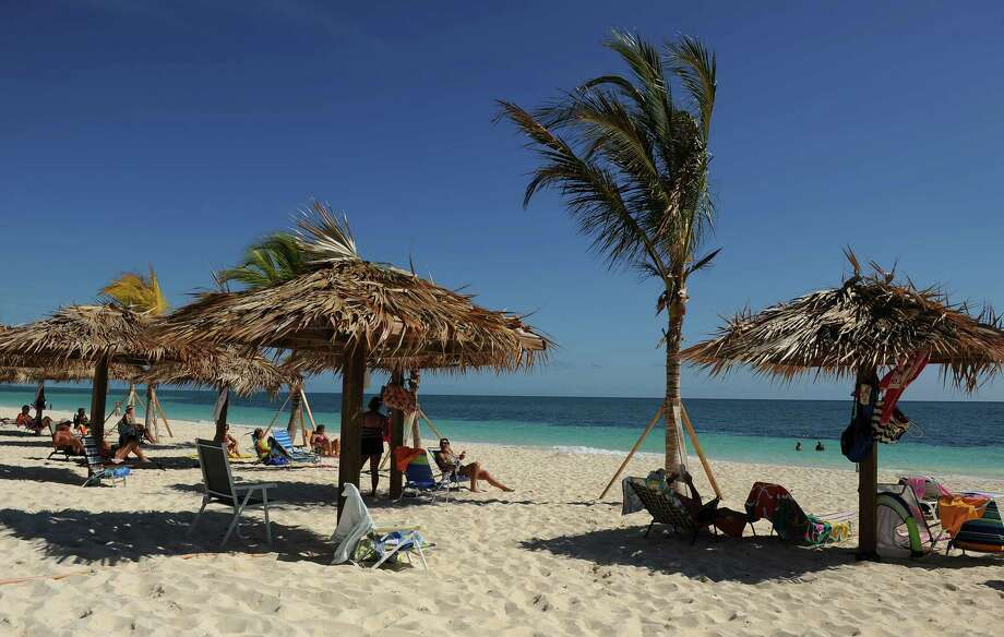 FreeportFolks enjoy the afternoon sun at Coral Beach at this Bahamian port.  Cruise here with Carnival. Photo: The Washington Post, Getty Images / 2011 The Washington Post