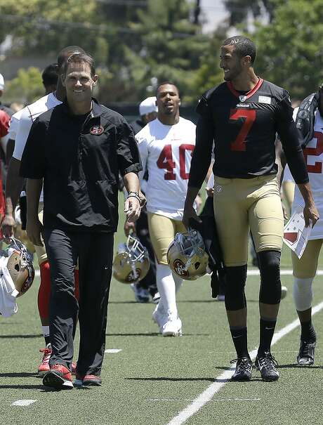 San Francisco 49ers quarterback Colin Kaepernick (7) walks off the practice field with general manager Trent Baalke during NFL football minicamp in Santa Clara, Calif., Thursday, June 19, 2014. (AP Photo/Jeff Chiu) Photo: Jeff Chiu, Associated Press