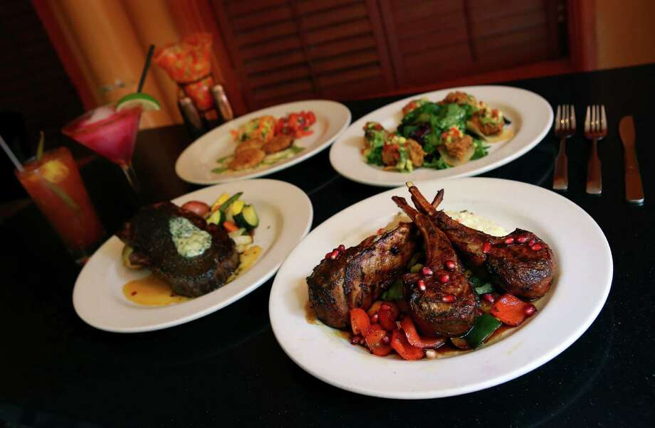 Now this is a River Walk party: (from left) Boudro's bloody mary, prickly pear margarita, blackened prime rib, seacakes, chile fried Gulf oysters and lamb chops. Photo: Photos By Timothy Tai / San Antonio Express-News / © 2014 San Antonio Express-News
