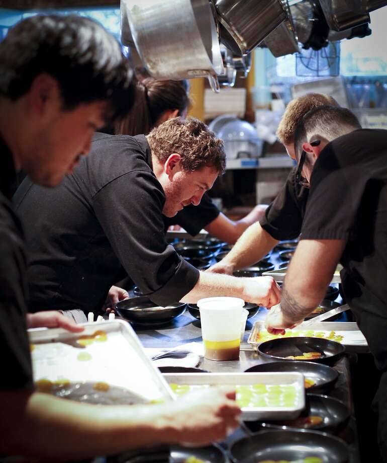 Chef David Barzelay (center) works with his crew at a Lazy Bear event. Photo: Sarah Rice, Special To The Chronicle