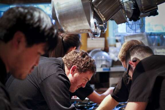 Chef David Barzelay, center, works with his crew at a Lazy Bear underground dinner event in San Francisco, Calif., on Monday, June 9, 2014.