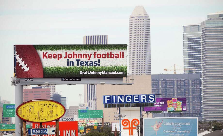A billboard urging the Houston Texans to draft Texas A&M quarterback Johnny Manziel is shown Wednesday, Jan. 29, 2014, in Houston. ( Brett Coomer / Houston Chronicle ) Photo: Brett Coomer, Staff / © 2014 Houston Chronicle