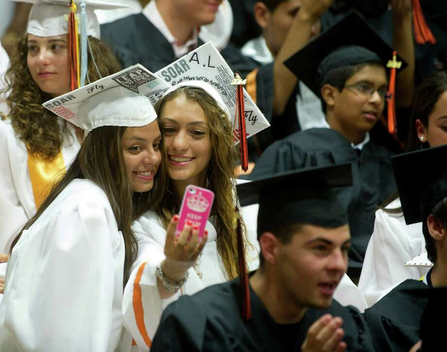 Graduates take a selfie before the Stamford High School commencement ceremony on Thursday, June 19, 2014. Photo: Lindsay Perry / Stamford Advocate