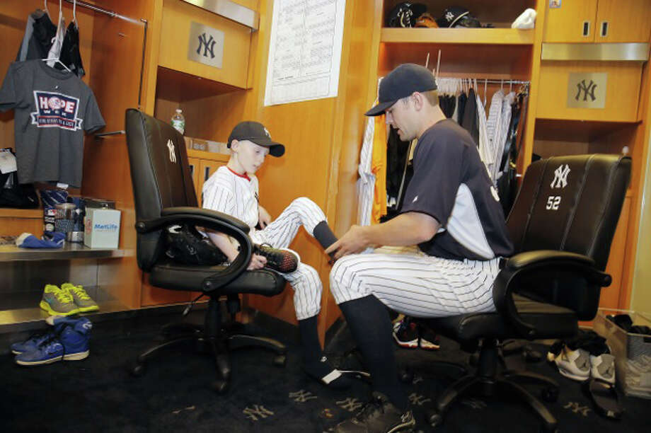 Yankees closer David Robertson helps HOPE Week honoree Sean Callahan to get ready for Wednesday night's game. Photo: Contributed Photo, New York Yankees/Contributed Pho / Stamford Advocate Contributed