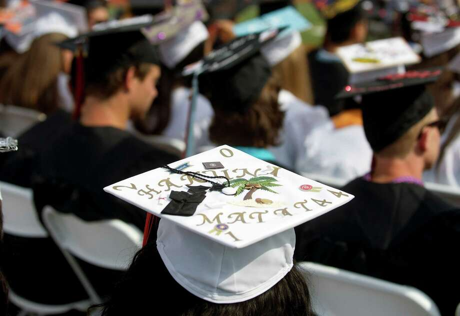 Decorated mortarboards stand out at the Stamford High School commencement ceremony on Thursday, June 19, 2014. Photo: Lindsay Perry / Stamford Advocate