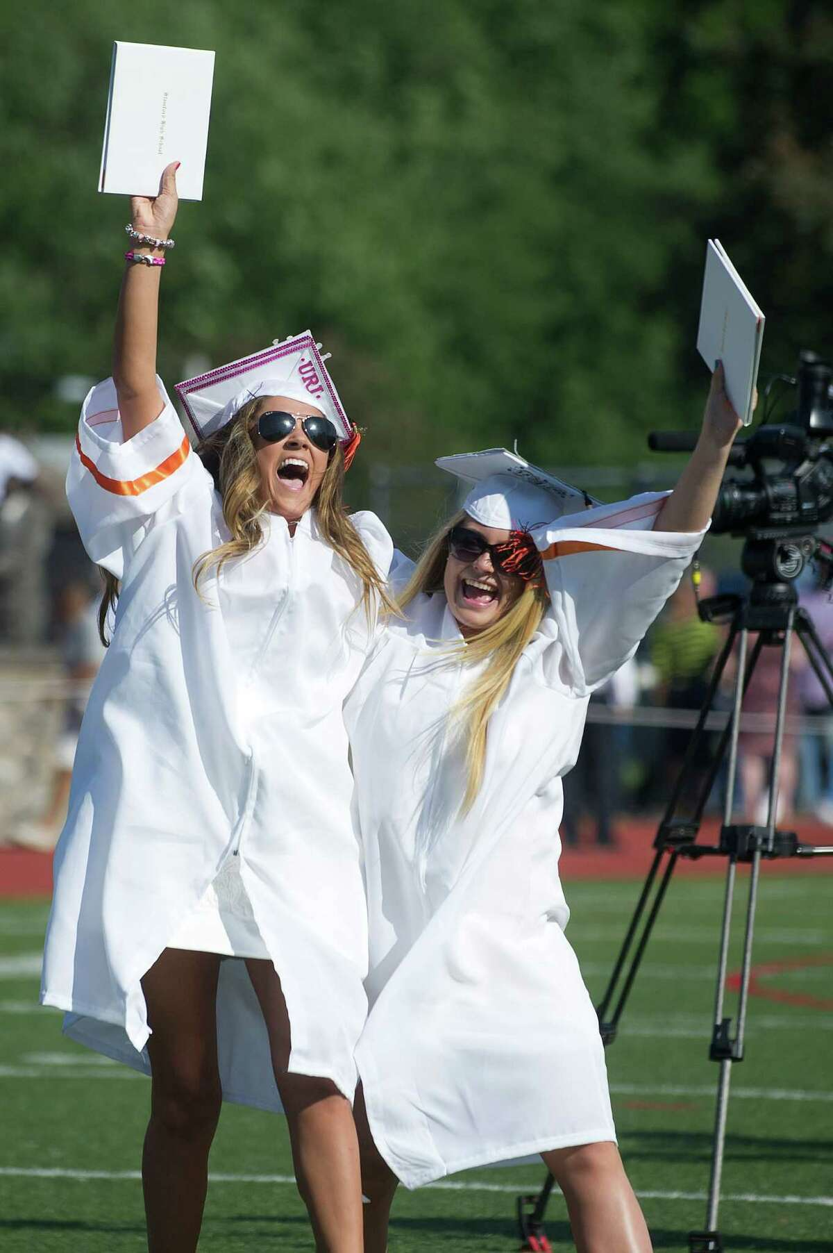 Graduates celebrate after getting their diplomas during the Stamford High School commencement ceremony on Thursday, June 19, 2014.