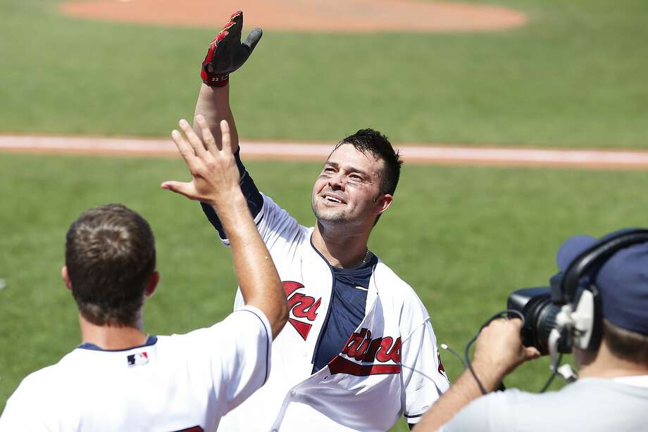 The Indians' Nick Swisher gestures to the crowd after his game-ending grand slam against the Angels. Photo: Joe Robbins, Getty Images