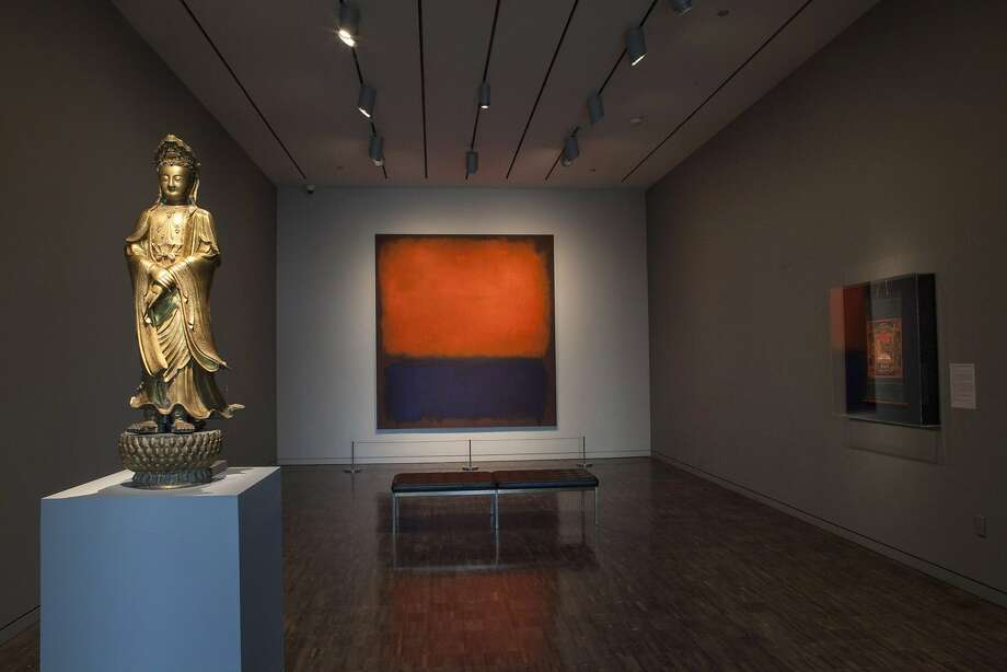 "An installation view of ""Gorgeous,"" mixing Asian Art Museum and San Francisco Museum of Modern Art pieces, features Bodhisattva Avalokiteshvara (Quanyin) (1600-1700), gilt bronze (left), and Mark Rothko's ""No. 14, 1960,"" oil on canvas. Photo: Kaz Tsuruta, Asian Art Museum, S.f."