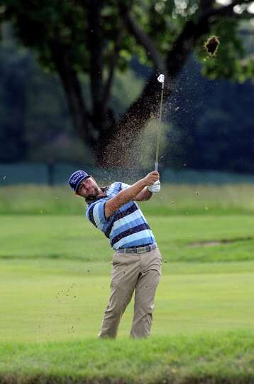 Ryan Moore watches his approach shot on the ninth hole during the first round of the Travelers Champ