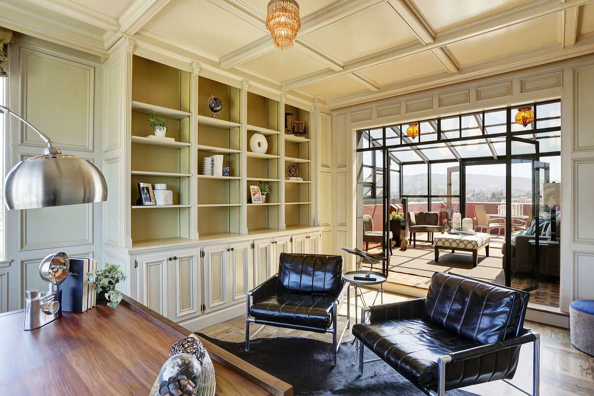 Wainscoting and bookshelves are among the architectural details of the office.