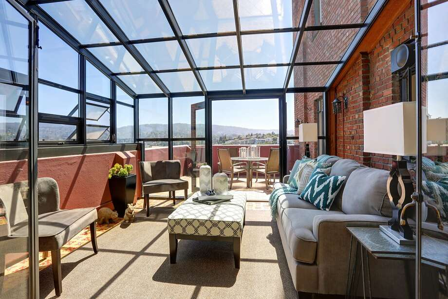 A glass-walled patio at 492 Staten Ave. in Oakland provides a sheltered place to stargaze and appreciate the sweeping vistas. Photo: Liz Rusby/The Grubb Co.