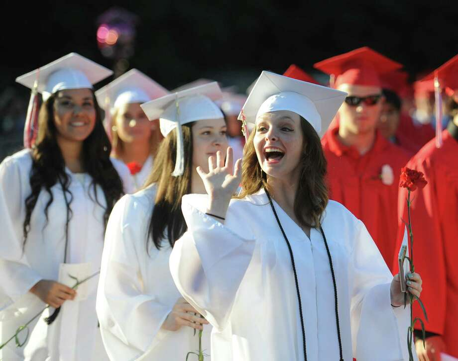 Kendall Polverari waves to the crowd during the Masuk High School 2014 Graduation Ceremony at Masuk High School in Monroe, Conn. Thursday, June 19, 2014. Photo: Tyler Sizemore / The News-Times