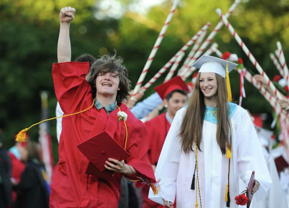 Alex Bachard celebrates after receieving his diploma at the Masuk High School 2014 Graduation Ceremony at Masuk High School in Monroe, Conn. Thursday, June 19, 2014. Photo: Tyler Sizemore / The News-Times